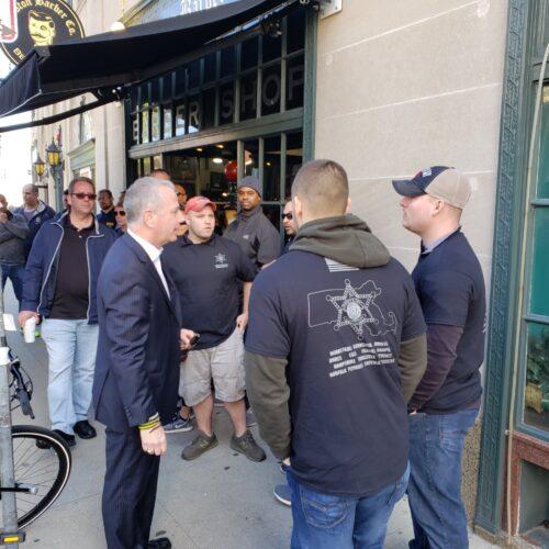 Members speak with State Rep Hank Naughton